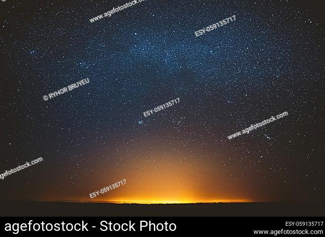 Awesome Beautiful Night Sky Glowing Stars Background Backdrop With Colorful Sky Gradient. Sunset Sunrise Light And Colourful Night Starry Sky In Blue Yellow...