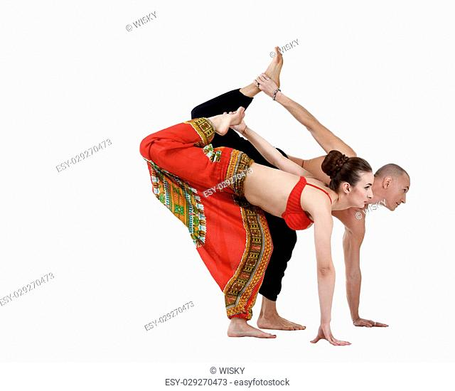Paired yoga training of man and woman, isolated on white
