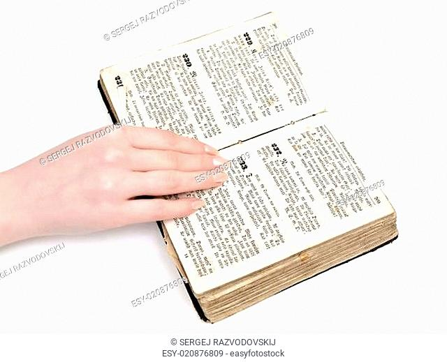 woman hand on old book