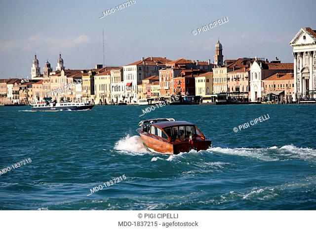 A water taxi crossing the Giudecca Canal