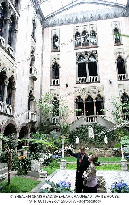 Stan Kozak, Chief Horticulturist of the Gardner Museum, guides Mrs. Laura Bush though a tour of the interior courtyard garden, Tuesday, April 24, 2006