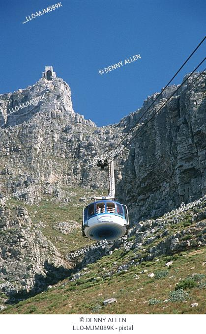 Low-angle shot of Table Mountain cable-car, Cape Town, Western Cape Province, South Africa