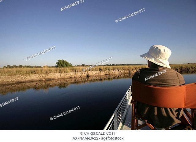 Tourist taking a boat trip on Kwando River