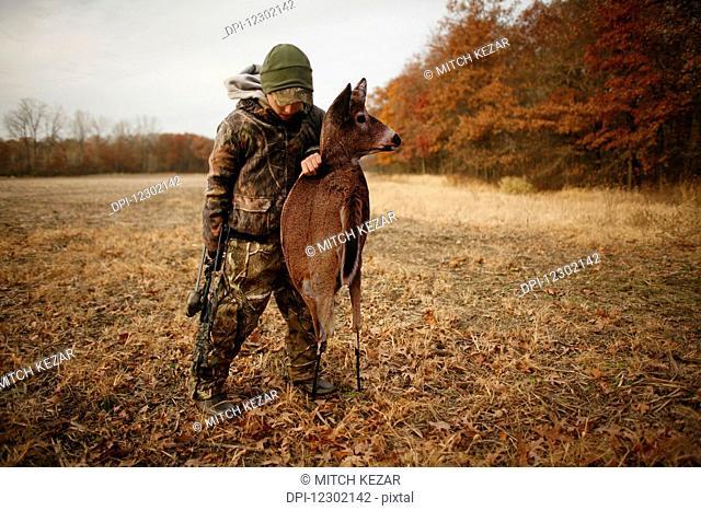 Deer Hunter With Deer Decoy