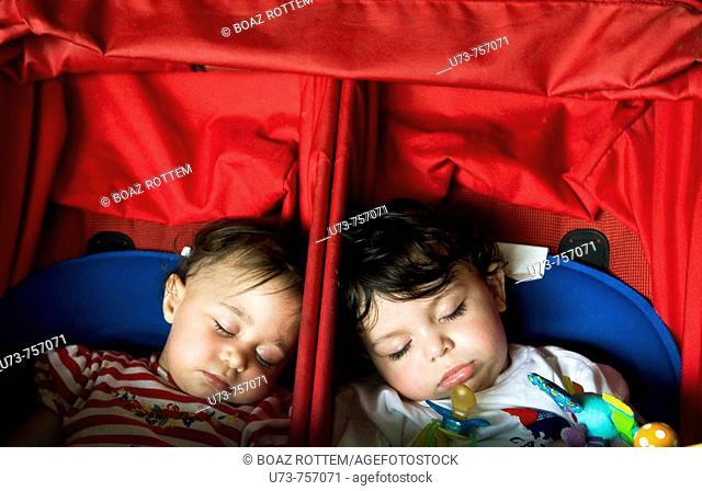 Cute twins fast asleep