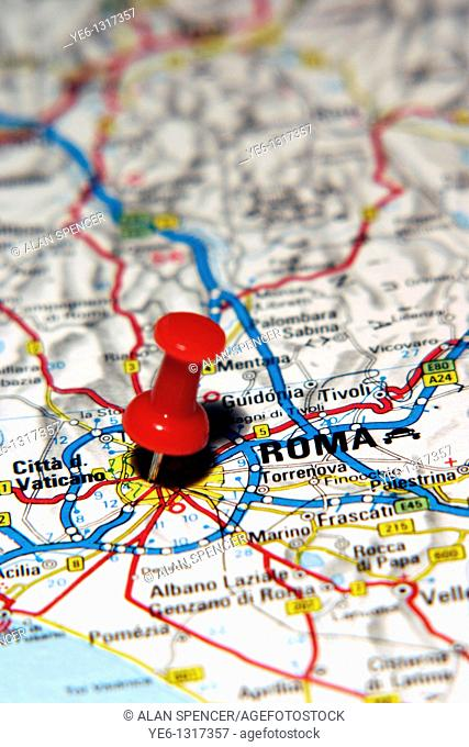 Map Pin pointing to the City of Rome, Italy on a road map