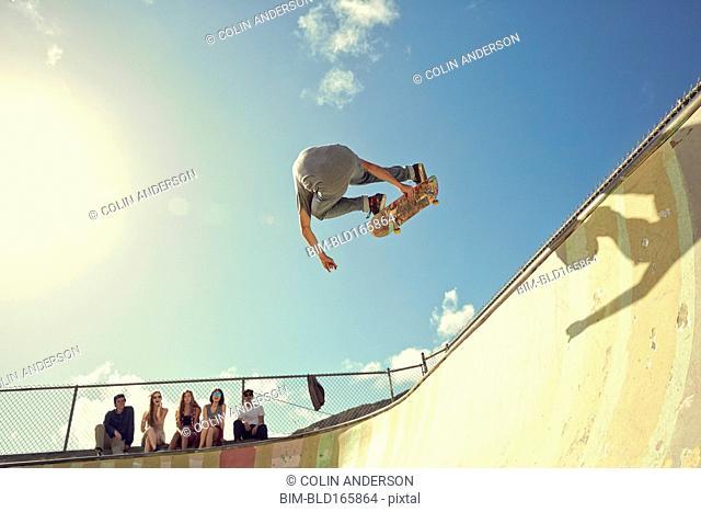 Man performing trick on skateboard at skate park