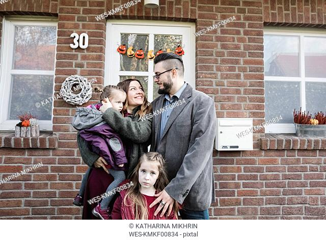Portrait of family in front of their house