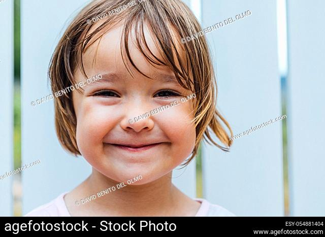 Portrait of blond-haired girl smiling