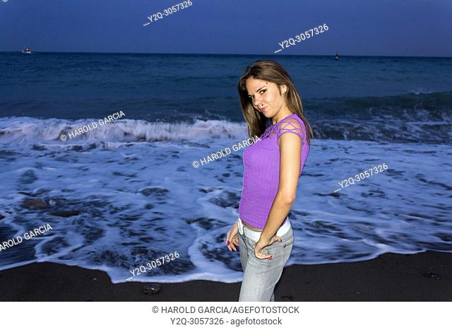 Beautiful, attractive Ukrainian woman posing near the black sea for a photographic sequence in Yalta, Crimea