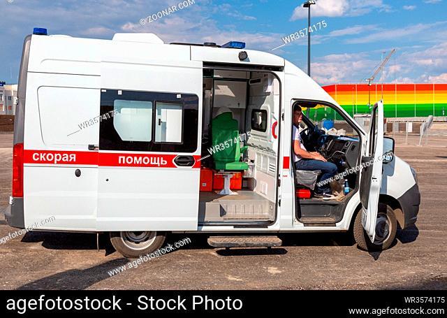 Samara, Russia - May 16, 2018: Ambulance car parked up near the Samara Arena football stadium. Text in russian: