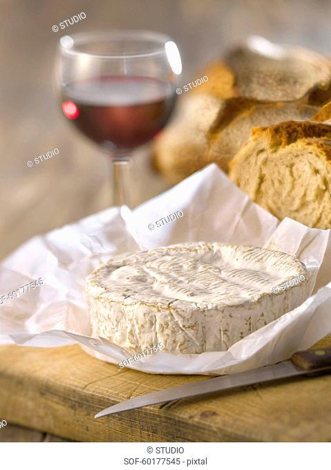 Camembert,bread and a glass of red wine