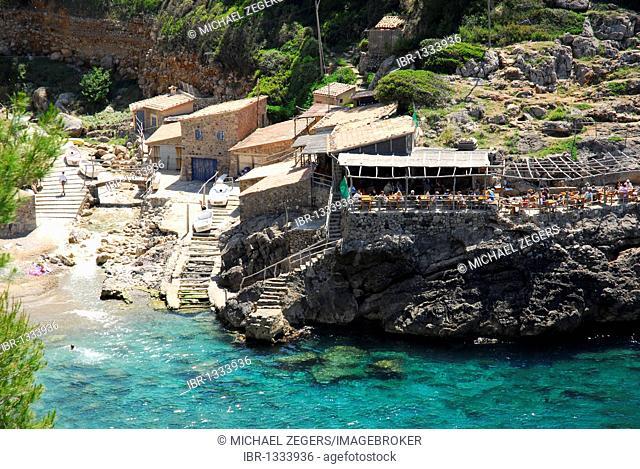 Houses with bar cafe terrace in the Cala de Deia bay, Mallorca, Majorca, Balearic Islands, Mediterranean Sea, Spain, Europe