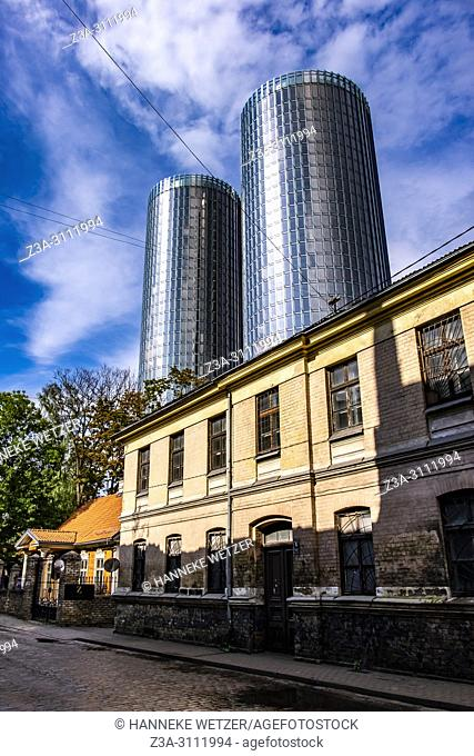Traditional houses in front of the newly built Z-Towers in Riga, Latvia, Europe