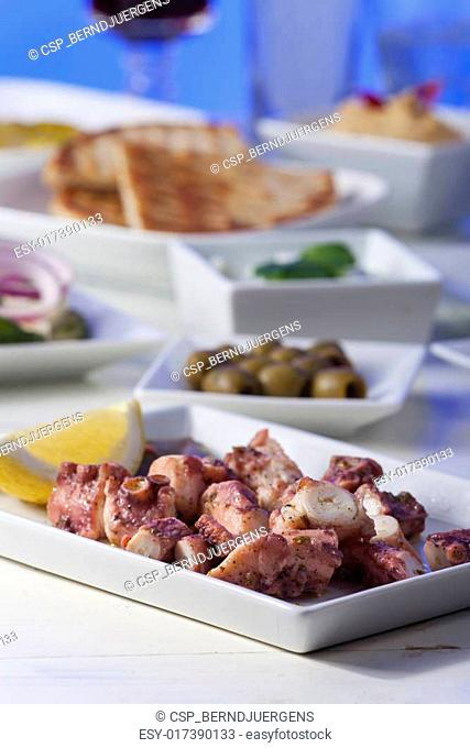 greek octopus salad with a lemon