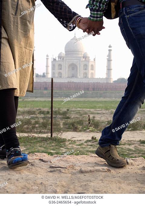Couple walking in front of Taj Mahal, Agra, Uttar Pradesh, India