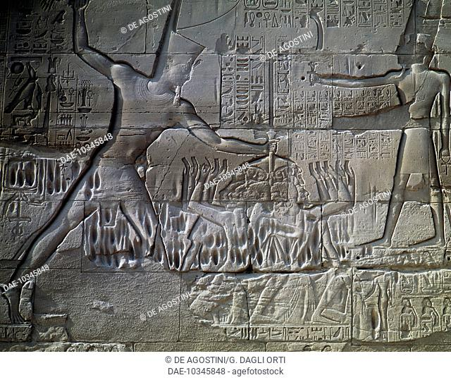 Libyan prisoners, relief, outer wall of the Great Hypostyle Hall, Temple of Amun, Karnak Temple Complex (Unesco World Heritage List, 1979)