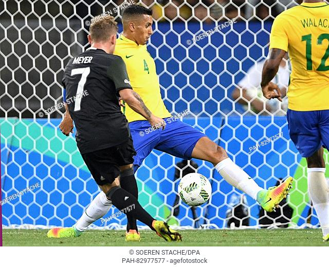 Maximilian Meyer of Germany scores the 1-1 equalizer as Marquinhos of Brazil is tunneled during the Men's soccer Gold Medal Match between Brazil and Germany...