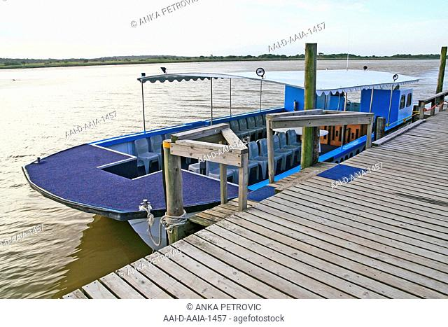 Santa Lucia ferry cruise boat Wooden dock at St Lucia Estuary, St Lucia, KwaZulu Natal, South Africa. 17/03/2011
