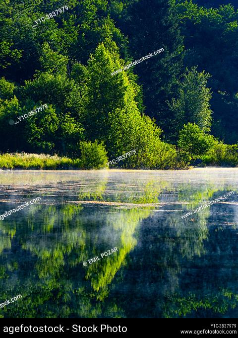 Misty water surface lake Mrzla vodica in Croatia