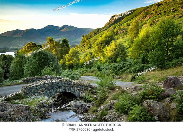 Ashness Bridge and the last rays of sunlight on the mountains above Derwentwater, the Lake District, Cumbria, England