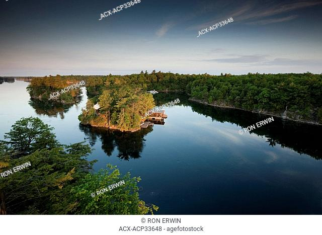 View from the Thousand Islands Bridge of treetops foreground left below on Constance Island and Georgina Island back right