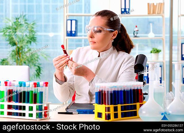Female chemist working in medical lab