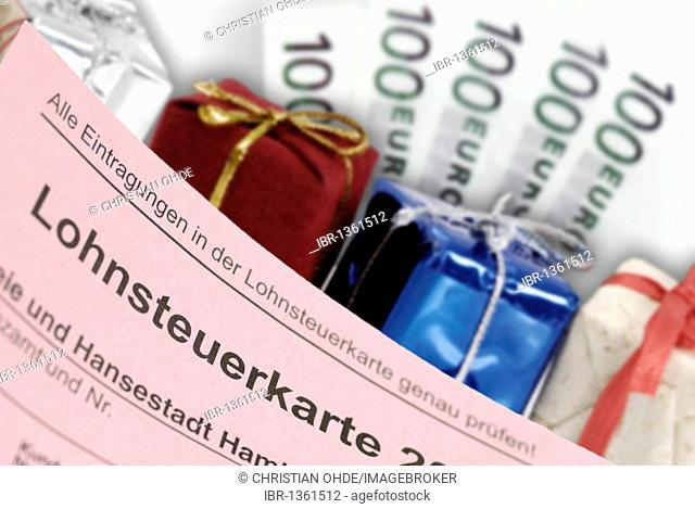 Tax card, gifts and banknotes, symbolic image of tax giveaways