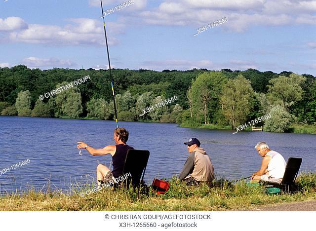 fishermen by the Vaux pond, Nievre department, region of Burgundy, center of France, Europe