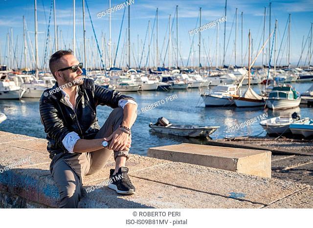Man in harbor looking away, Cagliari, Sardinia, Italy, Europe