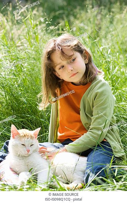 A girl stroking a cat