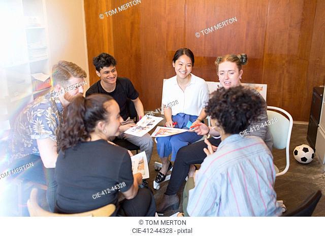 Creative designers meeting in circle