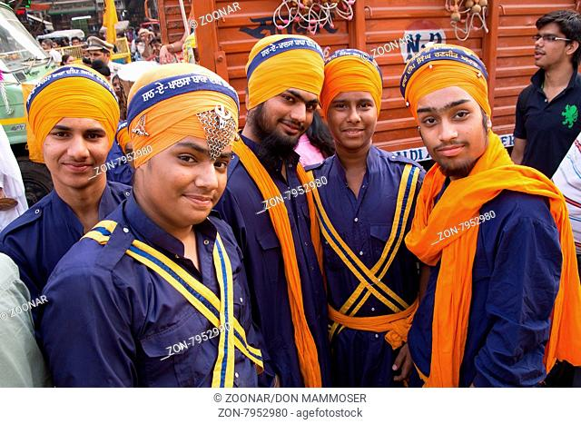 Young men taking part in Guru Nanak Gurpurab celebration in Delhi, India