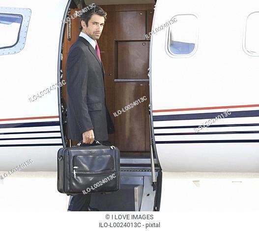 A businessman boarding a plane