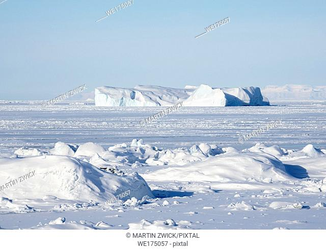 The frozen Disko Bay with icebergs at the Ilulissat Icefjord . The icefjord is listed as UNESCO world heritage. America, North America, Greenland, Denmark