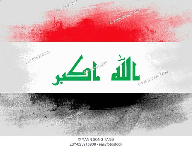 Flag of Iraq painted with brush on solid background