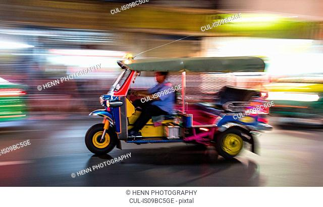 Tuk Tuks racing through Chinatown, Bangkok, Thailand
