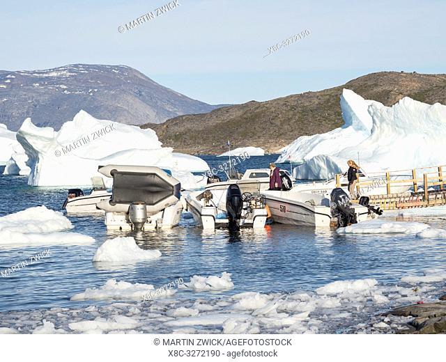 The harbour. Small fishing village Ikerasak on Ikerask island in the Uummannaq Fjord System. America, North America, Greenland, Uummannaq