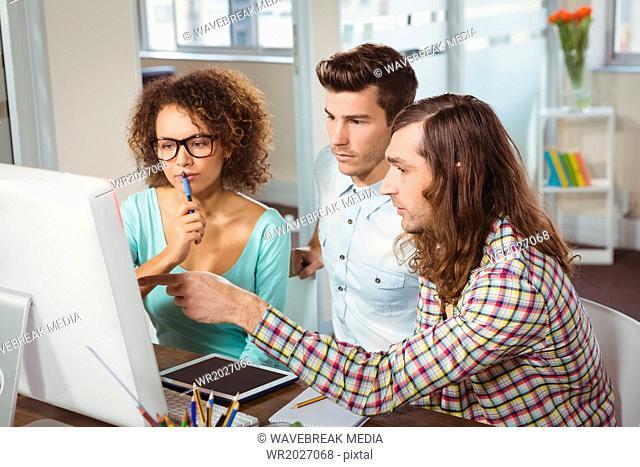 Businessman explaining on computer screen