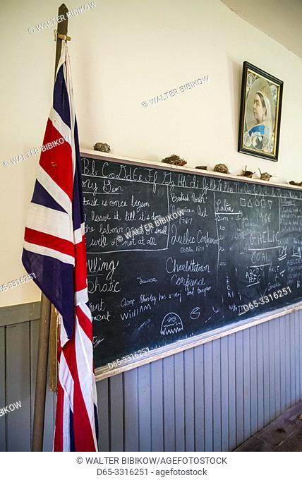 Canada, Prince Edward Island, Orwell, Orwell Corner Historic Village, Orwell School, b. 1895, interior with blackboard and portrait of British Queen Victoria