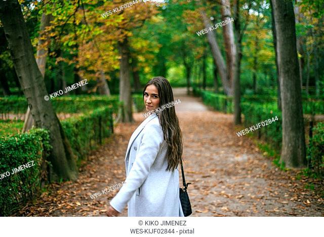 Portrait of a woman walking in a park