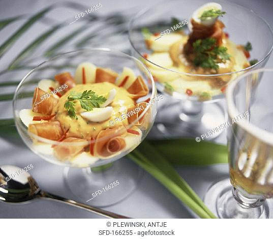 Palm heart cocktail with ham rolls and quail's eggs