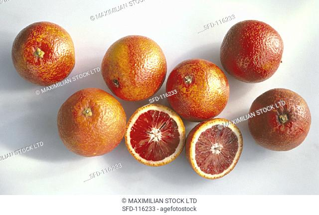 Several Blood Oranges, One Cut in Half