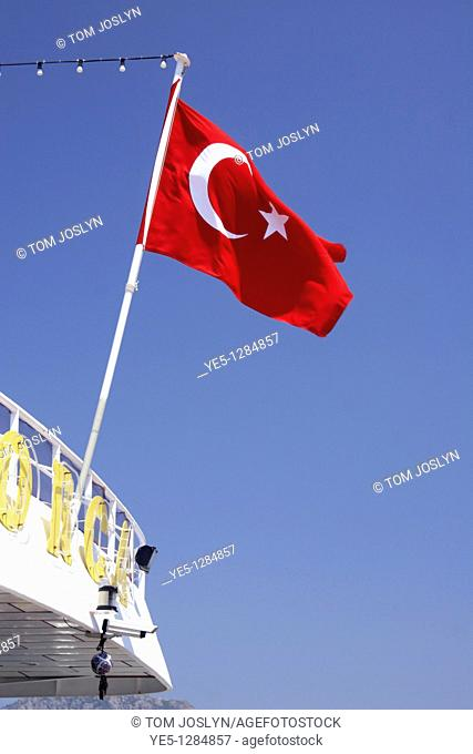 Turkish Flag flying in breeze on boat