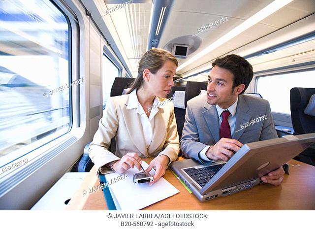 Businessmen working connected to the internet. Passenger. AVE, Tren de Alta Velocidad, Zaragoza, Aragón. Spain
