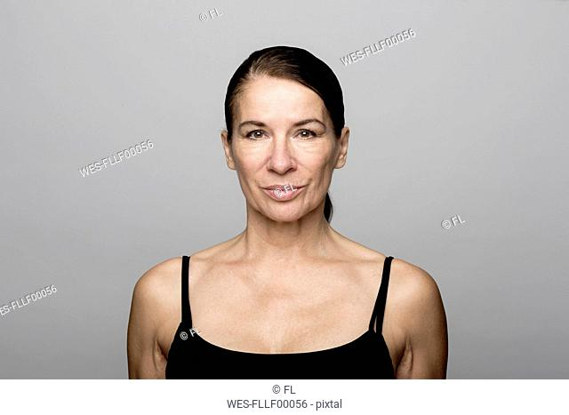 Portrait of serious mature woman wearing black top