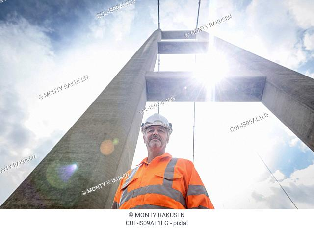 Portrait of worker on suspension bridge. The Humber Bridge, UK was built in 1981 and at the time was the world's largest single-span suspension bridge