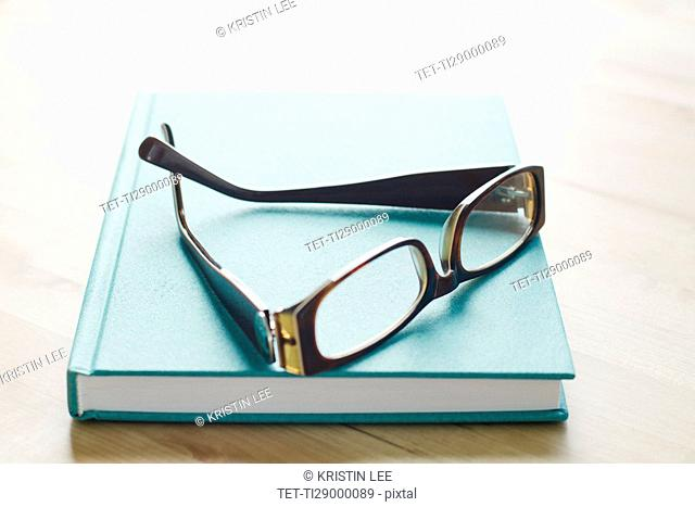 Studio shot of spectacles on book