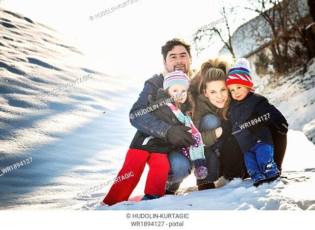 Happy family in snow