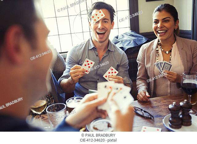 Friends playing Blind Man's Bluff at bar